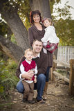 Attractive Parents and Children Portrait in Park Stock Photo