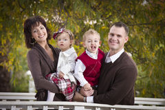 Attractive Parents and Children Portrait in Park Royalty Free Stock Images