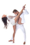 Attractive passionate dancers posing in studio Stock Image
