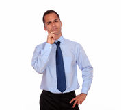 Attractive pensive adult man looking at you Royalty Free Stock Image