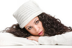 Attractive pensive brunette looking at camera. On white background Royalty Free Stock Images