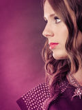Attractive pensive girl with long curly hair. Royalty Free Stock Photography
