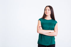 Attractive pensive young woman standing with hands folded Stock Image
