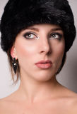 Attractive pensive young woman in a winter hat Royalty Free Stock Photography