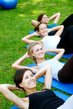 Attractive people doing fitness exercises Stock Photography