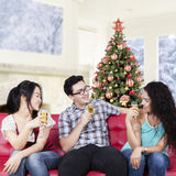 Attractive people enjoy champagne at home Royalty Free Stock Image