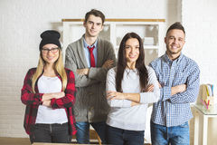 Attractive people with folded arms Stock Photography