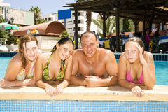 Attractive people in a pool Royalty Free Stock Images