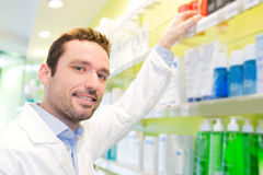 Attractive pharmacist clean the store up Royalty Free Stock Photography