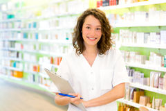 Attractive pharmacist taking notes at work Royalty Free Stock Image