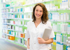 Attractive pharmacist using tablet at work Royalty Free Stock Photo