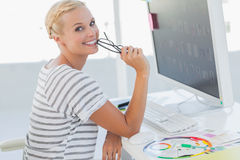 Attractive photo editor at her desk Royalty Free Stock Photos