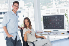 Attractive photo editors posing in their office Stock Photos