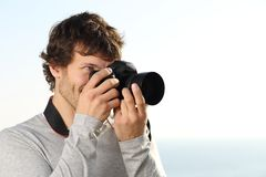 Attractive photograph photographing with a slr camera. Outdoor with the sky in the background Stock Image
