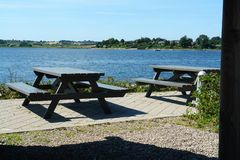Attractive picnic tables by the sea Royalty Free Stock Photo