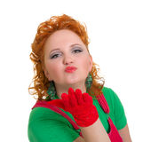 Attractive pin-up girl blowing a kiss Stock Image