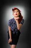 Attractive pin up girl blowing a kiss Stock Images