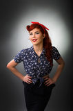 Attractive pin up girl posing with hands on waist Stock Photos