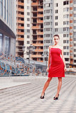 Attractive pin-up girl in red dress Stock Photos