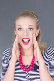 Attractive pinup girl in striped dress screaming Royalty Free Stock Photos