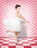 Attractive pinup woman running in surprise Royalty Free Stock Photography