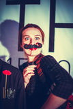 Attractive playful beautiful young woman holding mustache on a stick Royalty Free Stock Photography