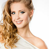 An attractive portrait of a cute smiling girl blonde with clean Stock Image