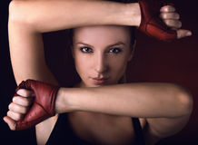 Attractive posing blonde in a red sport gloves. Fashion photo Stock Photos