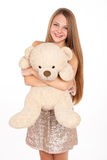 Attractive positive blonde hugging a teddy bear Stock Photography