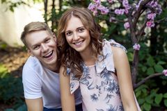 Attractive positive couple toothy smiling at camera. Outdoor shot, spring park or summer concept. Love, sensual people Stock Images