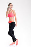 Attractive positive fitness girl talking on mobile phone Stock Photo
