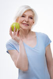 Attractive positive woman demonstrating tasty apple Stock Images