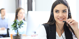 Attractive positive young businesspeople and colleagues in a call center office. Stock Images