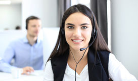 Attractive positive young businesspeople and colleagues in a call center office. Stock Photography