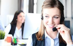 Attractive positive young businesspeople and colleagues in a call center office. Royalty Free Stock Image