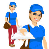 Attractive post woman in blue shirt uniform delivering mail with brown leather bag Stock Image