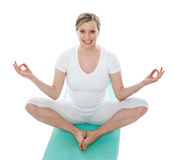 Attractive pregnant female doing exercise Royalty Free Stock Photography