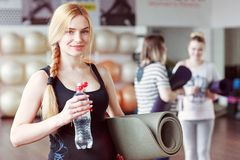 Attractive pregnant woman with bottle of water after gym royalty free stock photos