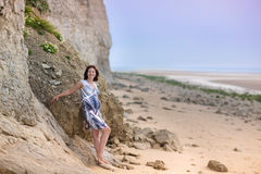 Attractive pregnant woman relaxing at a beautiful beach Stock Photography