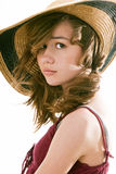 Attractive Preteen Female Model. Pretty preteen girl model wearing a fashionable straw hat Royalty Free Stock Image