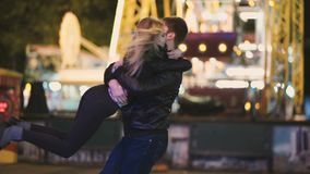 Attractive pretty couple spends date night at amusement park at night stock video