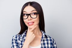 Attractive pretty girl in casual clothing and spectacles is thin Royalty Free Stock Photography