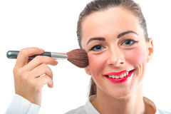 Attractive pretty smiling woman applying make up Royalty Free Stock Images