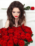 Attractive pretty woman with red roses bouquet, valentines day. Royalty Free Stock Images