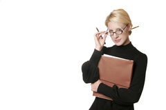 Attractive Professional/Academic Woman. An attractive blonde woman wearing glasses and holding files, with pencil in bun- looking studious, academic Royalty Free Stock Photos