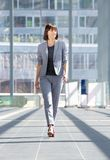 Attractive professional business woman walking royalty free stock photos