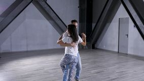 Attractive and professional dancers reharsing in big studio hall. Sport and healthy lifestyle stock footage