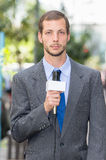 Attractive professional male news reporter wearing Stock Image