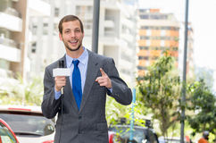 Attractive professional male news reporter wearing Royalty Free Stock Image