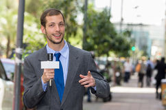 Attractive professional male news reporter wearing Stock Images
